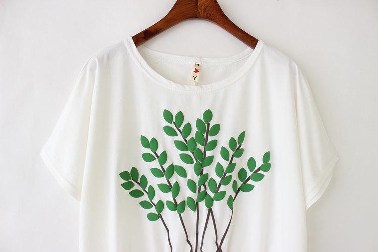 树叶做裙子的粘贴画