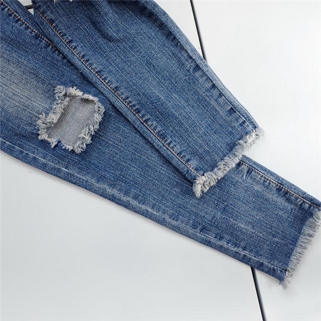腰显瘦破洞毛边牛仔裤